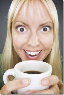 Beautiful Woman Enjoys Coffee